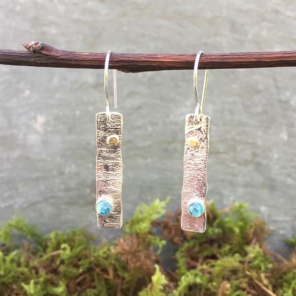 Swiss blue gems in silver earrings