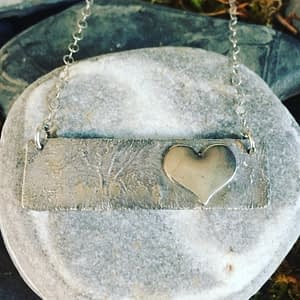 Saucy Jewelry textured pendant with heart