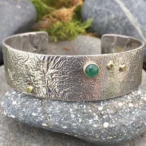 Saucy Jewelry reticulated cuff with emerald gemstone