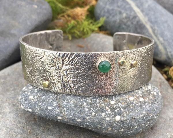 Saucy Jewelry reticulated cuff with emerald gemstone