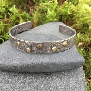 rough textured silver cuff with gold accents