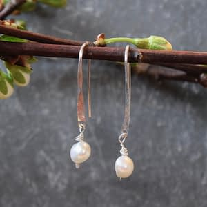 whisp with pearl earrings