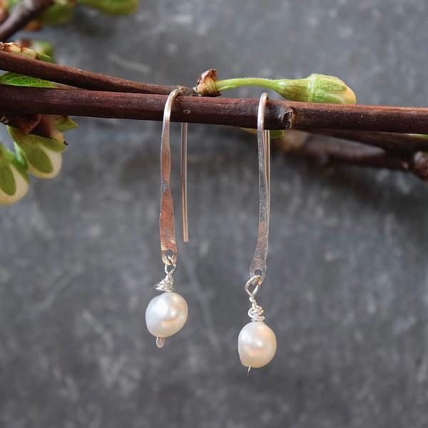 whisp with pearl earrings