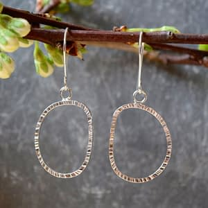 Saucy Jewelry dangling pounded silver earrings