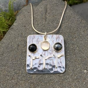 family gemstones on textured sterling silver pendant