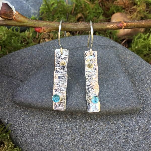 blue Swiss gemstones embedded in reticulated silver earrings