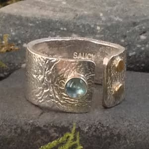 opening ring with Swiss blue topaz by Saucy Jewelry