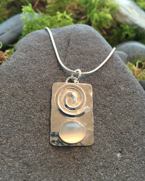 Saucy Jewelry rectangular pendant with spiral and large gemstone