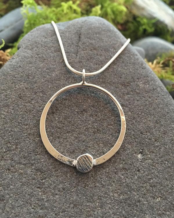 Saucy Jewelry circular luna pendant with textured metal