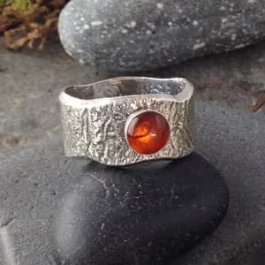 Saucy Jewelry - thick textured silver ring with red gemstone