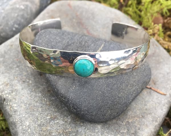 wide textured cuff with a gemstone by Saucy Jewelry