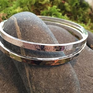sterling silver textured bangles by Saucy Jewelry