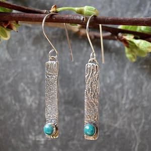 earrings by Saucy Jewelry topographical reticulation with gemstone