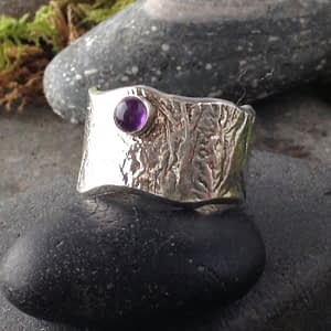 color burst reticulated ring with small gemstone