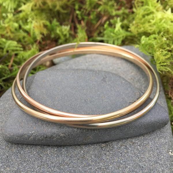 14kt gold interconnected bangle bracelets