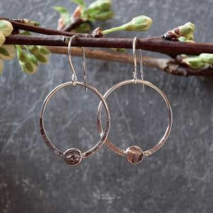 Silver hoop earrings with small gemstones by Saucy Jewelry