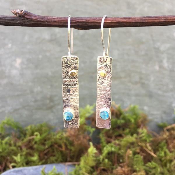 blue Swiss gemstones in silver earrings