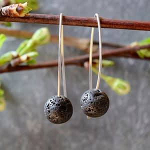 Saucy Jewelry dangling silver earrings with black lava rocks