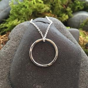 minimalist circle textured silver pendant