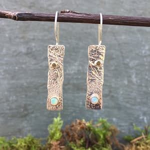 reticulated silver earrings with opal gemstones